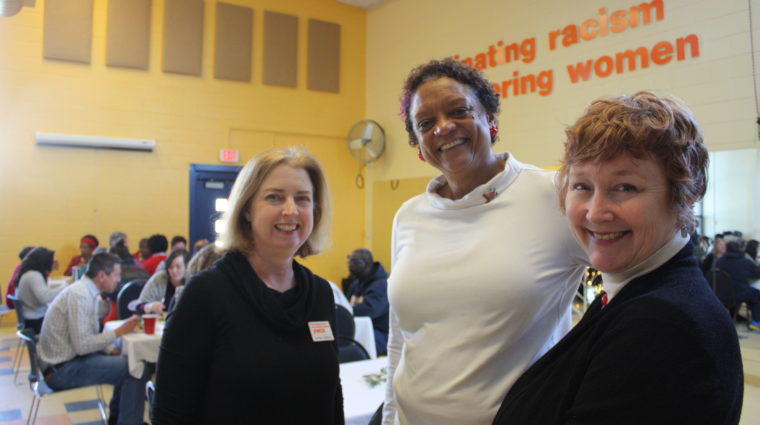 Members of the Board of Directors connect with staff at the YWCA Holiday Party