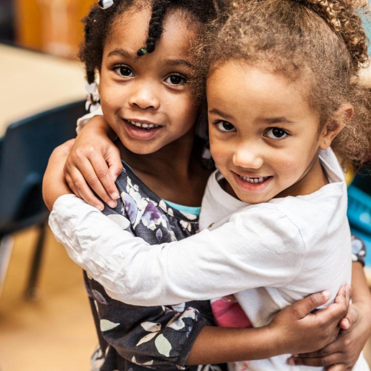 Childcare girls hugging